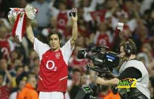Robert Pires holds the FA Cup aloft as h